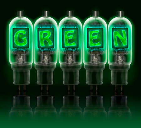 Word  GREEN  made with a row of color vacuum tubes with glowing letters inside isolated on black background  photo