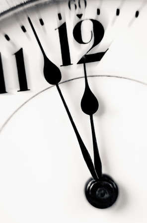 Antique clock closeup showing a few minutes to midnight  Concept of time,the past or deadline