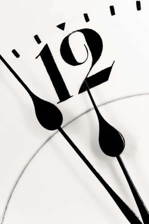 past midnight: Antique clock closeup showing a few minutes to midnight  Concept of time,the past or deadline