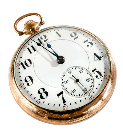 hands in pockets: Antique golden pocket watch showing a few minutes to midnight isolated on white background  Concept of time,the past or deadline