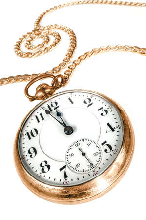 hands in pockets: Antique golden pocket watch with chain, showing a few minutes to midnight isolated on white background  Concept of time,the past or deadline  Stock Photo