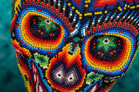 Colorful Beaded Skull from mexican traditional huichol bead art, symbol of the day of the dead