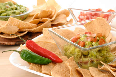 totopos: Fresh guacamole with corn tortilla chips and chili Stock Photo