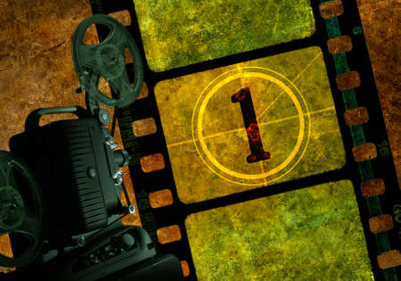 Vintage 8mm film projector with reels, colorful background with grunge textured film frames and a number one in countdown