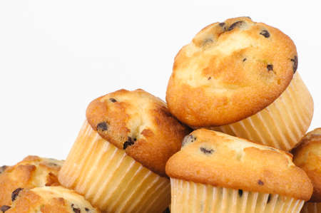 madalena: Bunch of chocolate chips Muffins on white background  Stock Photo