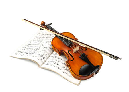 stringed: Violin and fiddle stick over score isolated on white