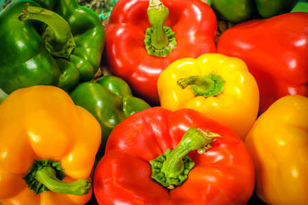 capsicums: Yellow, green and red colorful bell peppers, natural background Stock Photo