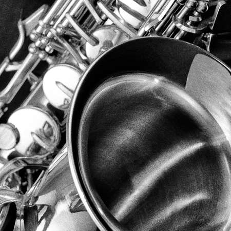 woodwind instrument: Saxophone woodwind instrument in black and white with film grain effect