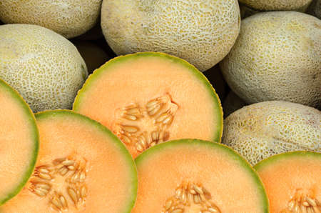 Cantaloupe melon pieces on a weekly fruit market