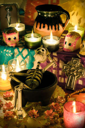 Traditional mexican Day of the Dead altar with skeleton, sugar skulls and candles photo