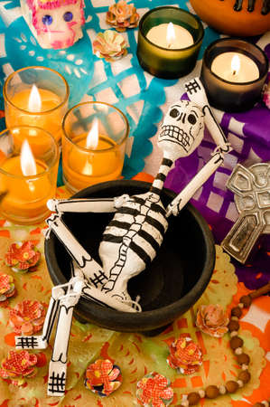 Traditional mexican Day of the Dead altar with skeleton, sugar skulls and candles
