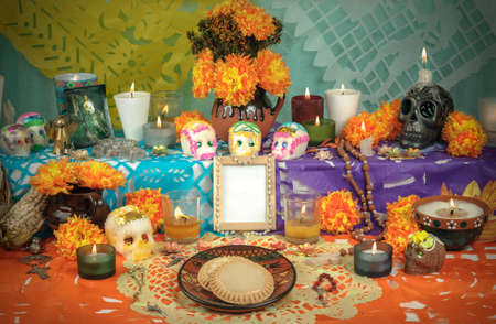 Traditional mexican Day of the dead altar with sugar skulls and candles photo