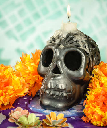 dia de los muertos: Day of the dead Oaxacan black clay Skull with candle Stock Photo