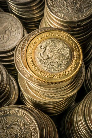 silver coins: A golden coin with an eagle over stacks of silver coins business wealth and success concept