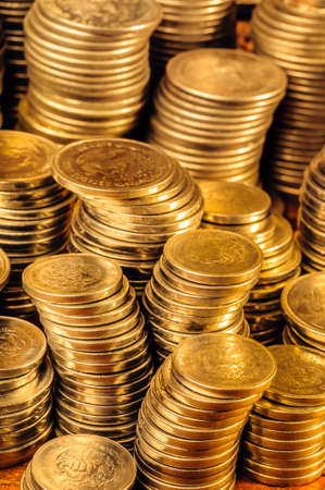 Golden coin stacks business wealth and success concept