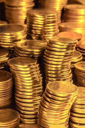 affluence: Golden coin stacks business wealth and success concept