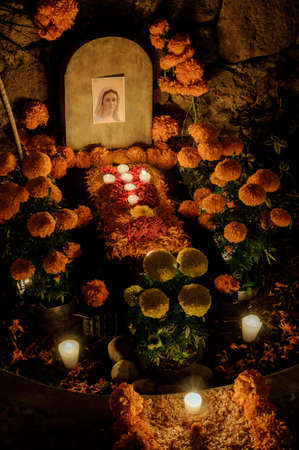 Traditional mexican Day of the dead altar with candles Stock Photo