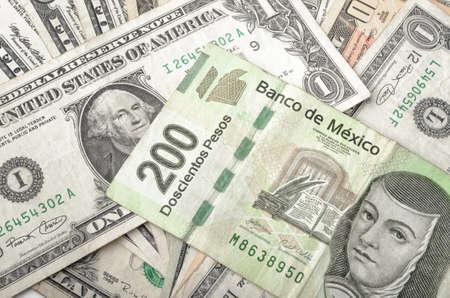 Dollars en Mexicaanse Peso diverse cash stapel achtergrond