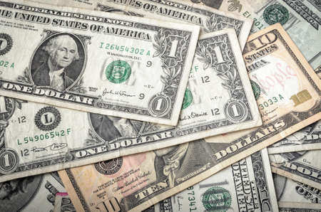 american currency: Dollar assorted bills, cash pile background Stock Photo