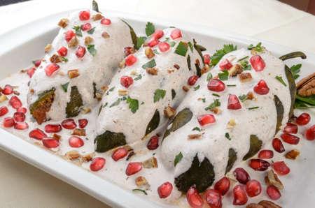 Chiles en nogada, a dish from Mexican cuisine Standard-Bild