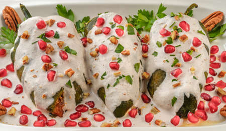 en: Chiles en nogada, a dish from Mexican cuisine Stock Photo