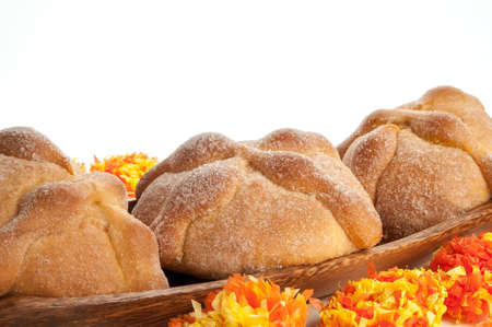 enjoyed: Sweet bread called Bread of the Dead (Pan de Muerto) enjoyed during Day of the Dead festivities in Mexico. Stock Photo