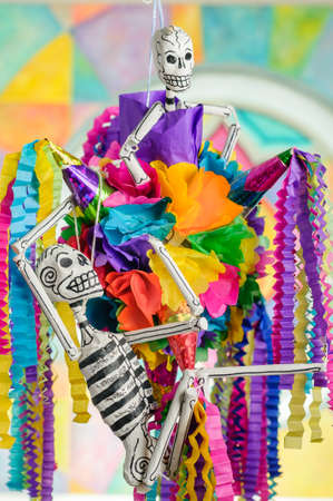 skull and flowers: Pinata with skeletons on day of the dead