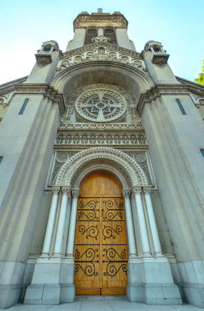 extreme angle: Church entrance with wooden door, extreme wide angle perspective Stock Photo