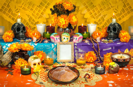 Day of the dead altar with sugar skulls and candles