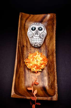 Sugar skull altar for Dia de los Muertos celebration, over black background