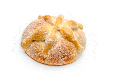 Sweet bread called Bread of the Dead Pan de Muerto enjoyed during Day of the Dead festivities in Mexico, Isolated on white background.
