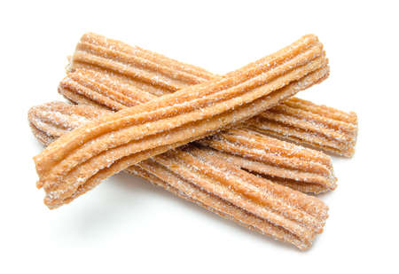 Churros stacked and isolated on white background Imagens