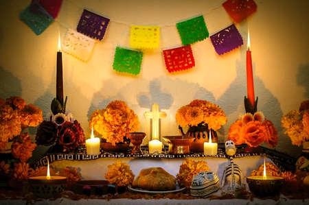 Traditional mexican Day of the dead altar with cempasuchil flowers and candles.
