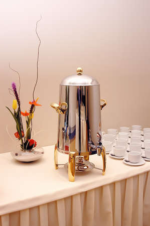 dispense: Luxurious and large grumet coffee dispenser for restaurants and events refreshment table with cups