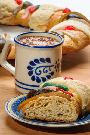 Chocolate cup with Epiphany cake, Kings cake, Roscon de reyes or Rosca de reyes Stock Photo