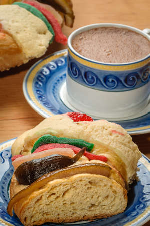Chocolate cup with Epiphany cake, Kings cake, Rosca de reyes or Roscon de reyes
