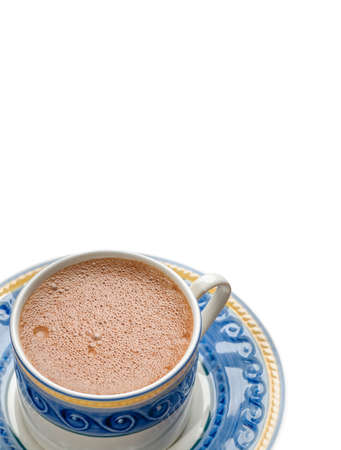 Traditional mexican chocolate cup made with cinnamon isolated on white background