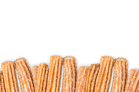 Churros arranged in row and isolated on white background Imagens