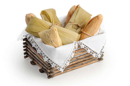 Tamales, Mexican dish made with corn dough, chicken and chili, wrapped with a corn leaf 스톡 콘텐츠