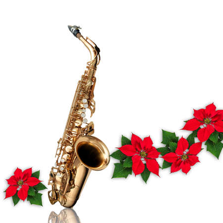 Saxophone with musical notes and Red Poinsettia flower christmas ornament isolated on white background
