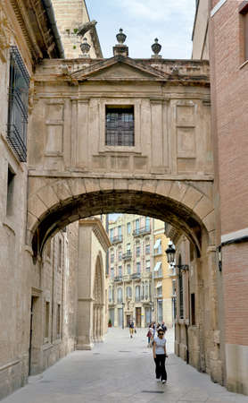 Valencia, Spain - June 8, 2018:Barchilla Street Arch between cathedral and Archbishops Palace in Valencia Spain
