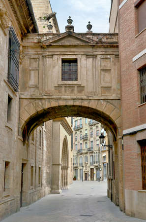 Barchilla Street Arch between cathedral and Archbishops Palace in Valencia Spain Stok Fotoğraf