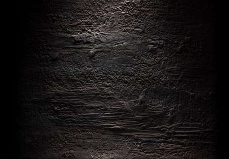 Grungy dark stucco wall with spotlight, background photo texture Stok Fotoğraf