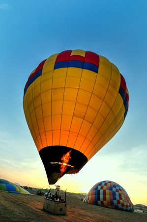 Teotihuacan, Mexico - April 6, 2019 : Colorful hot air balloon about to take off at dawn with blue sky near the town of Teotihuacan, Mexico. Editöryel