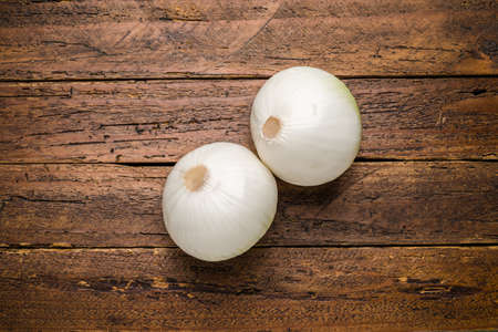 Top view fresh organic onion on wooden table top