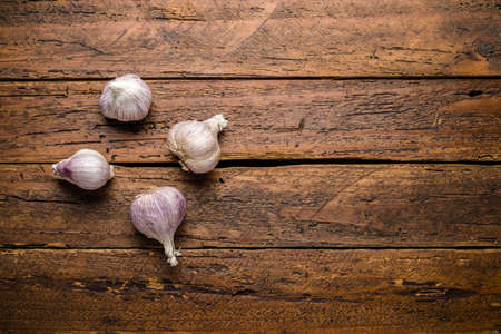 Top view fresh organic garlic on wooden table top