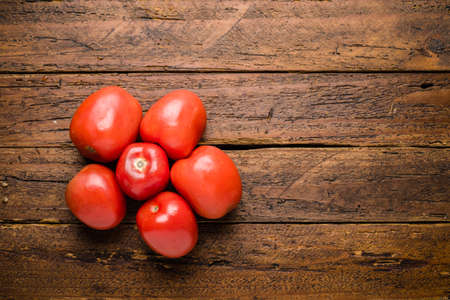 Top view fresh organic tomatoes  on wooden table top