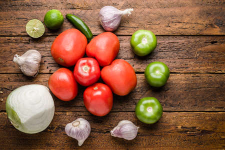 Mexican sauce ingredients Top view fresh organic vegetables and fruits on wooden table top