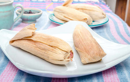 Sweet Tamale, Mexican dish made with corn dough with raisin and strawberry or pineapple flavored, wrapped with a corn leaf