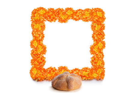 Cempasuchil flower frame with Sweet bread called Bread of the Dead (Pan de Muerto) enjoyed during Day of the Dead festivities in Mexico.